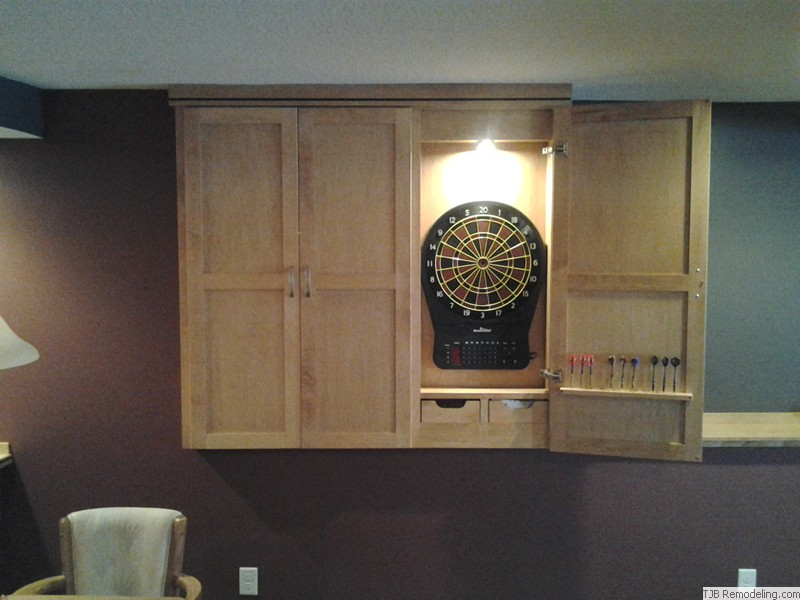Darts game concealed by cabinets