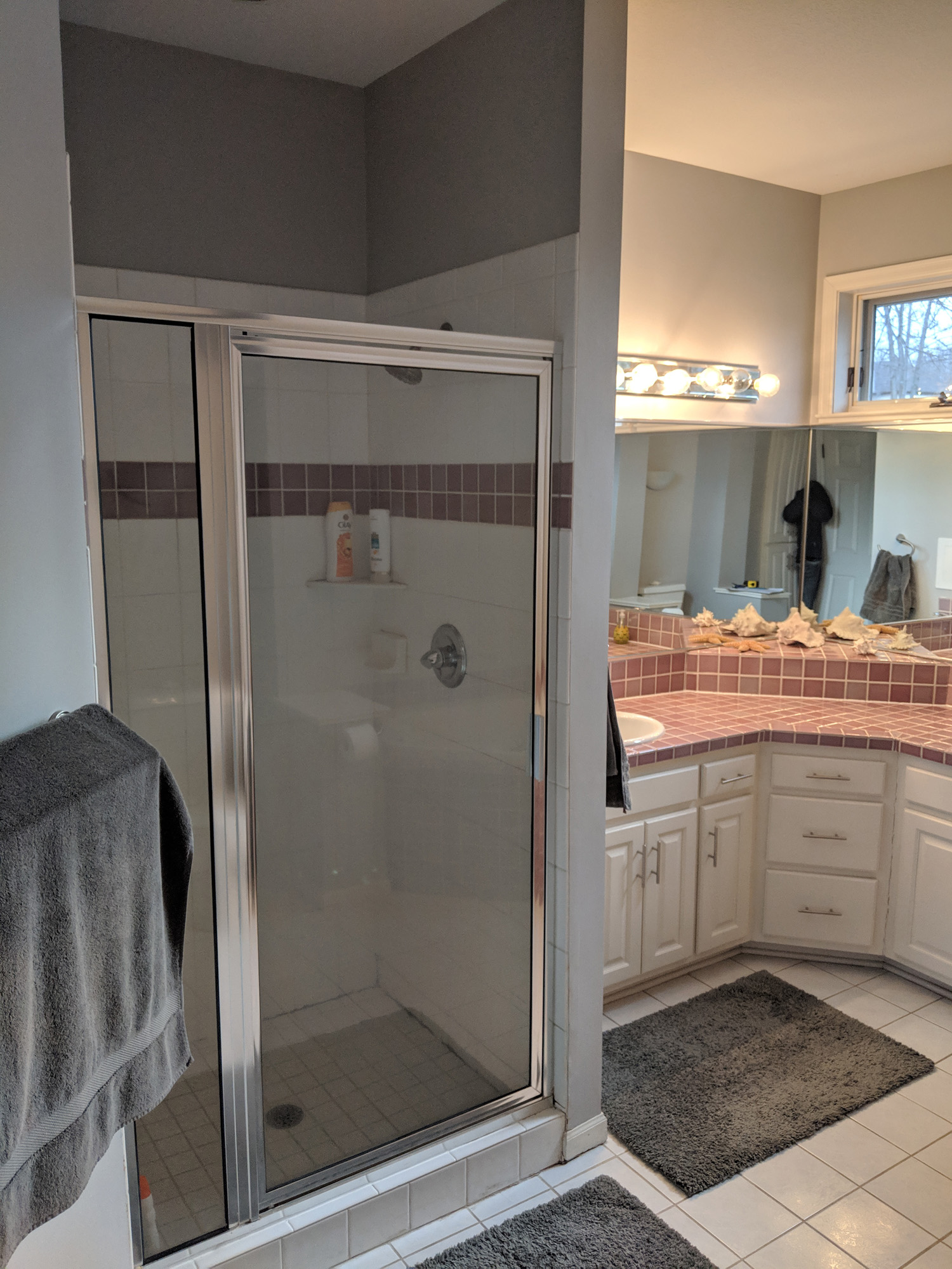 basic glass shower enclosure to be replaced with fancy glass corner shower