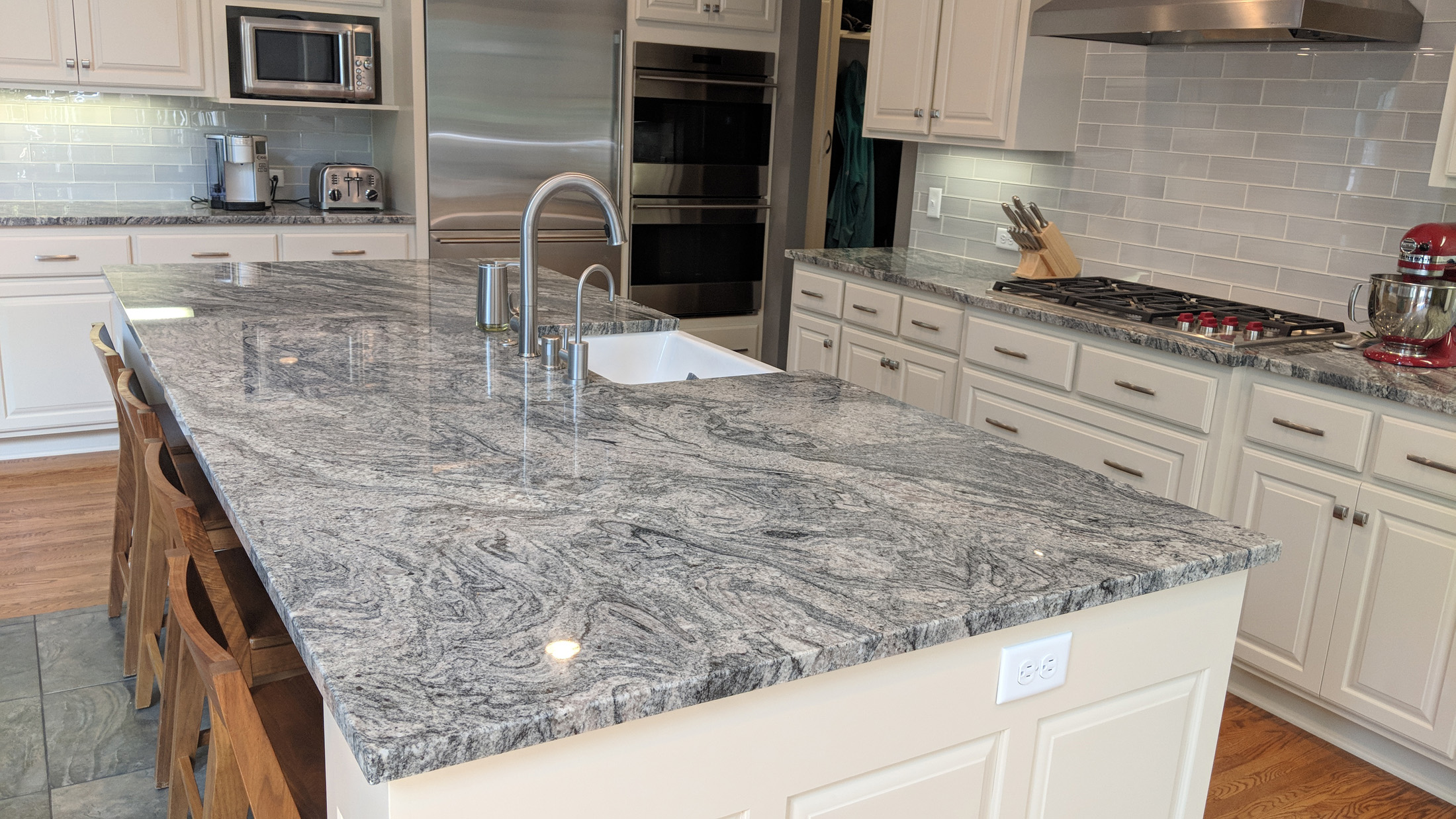 After - New Granite tops & enameled island cabinets