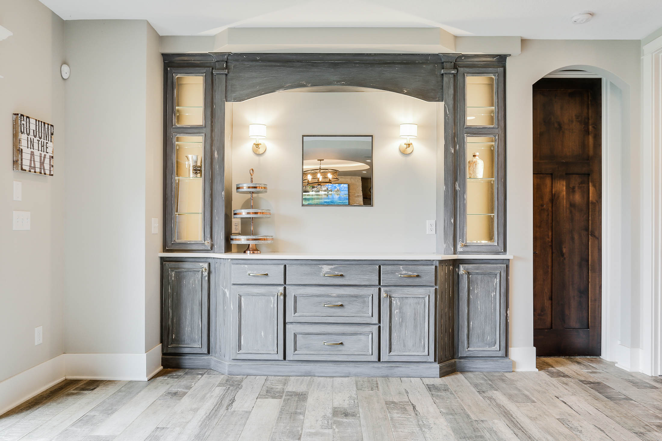 Built-in buffet with distressed enameled cabinets