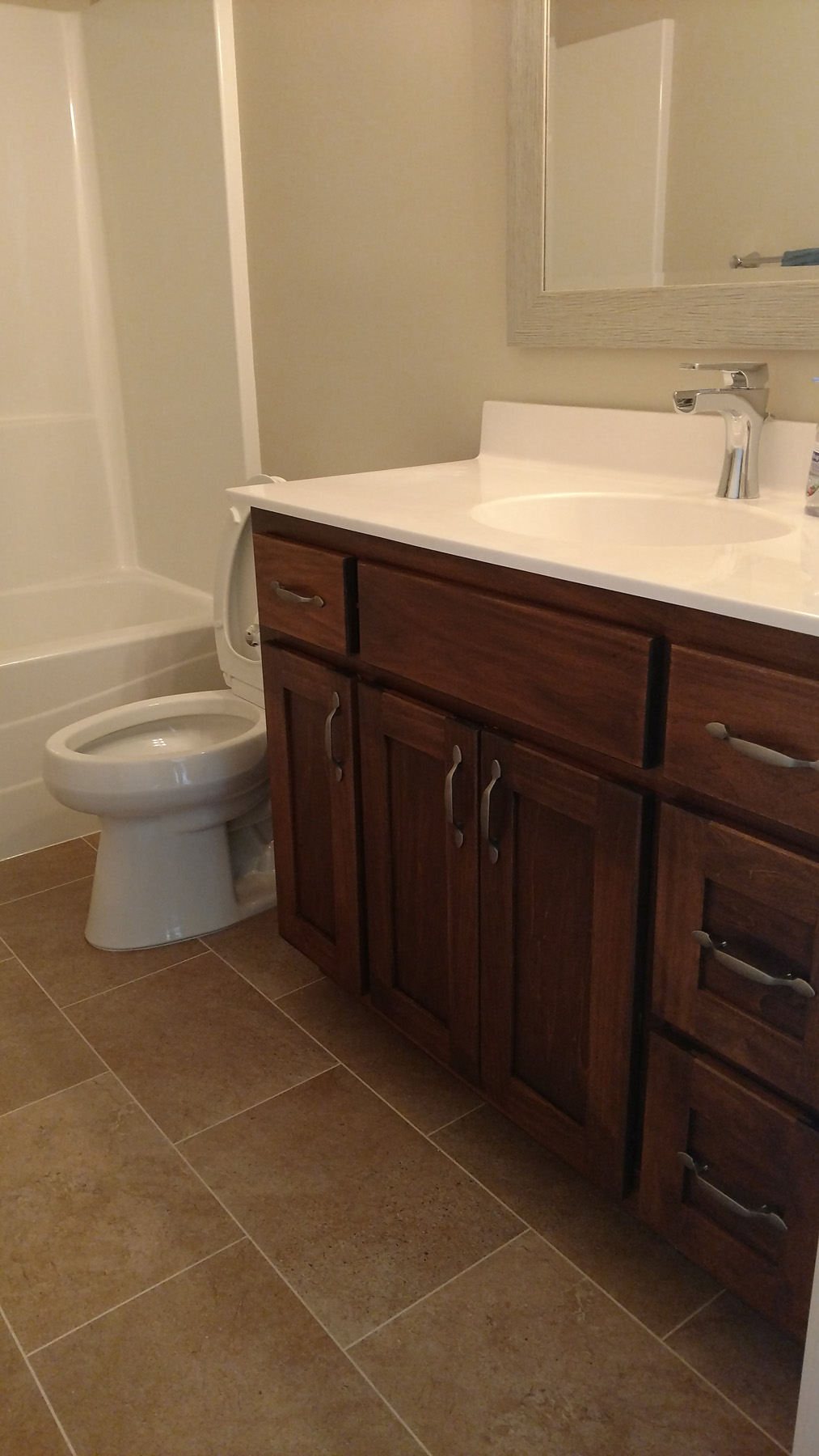 Bathroom with Knotty Alder Vanity Cabinets