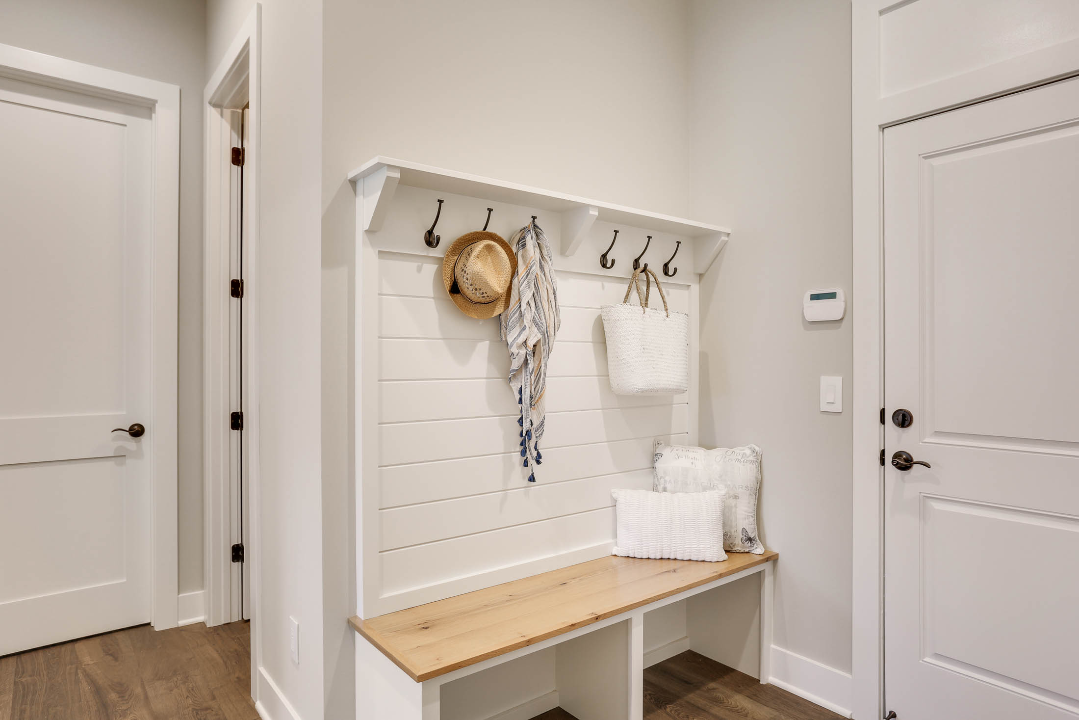 Built-in bench with cubbies and coat rack
