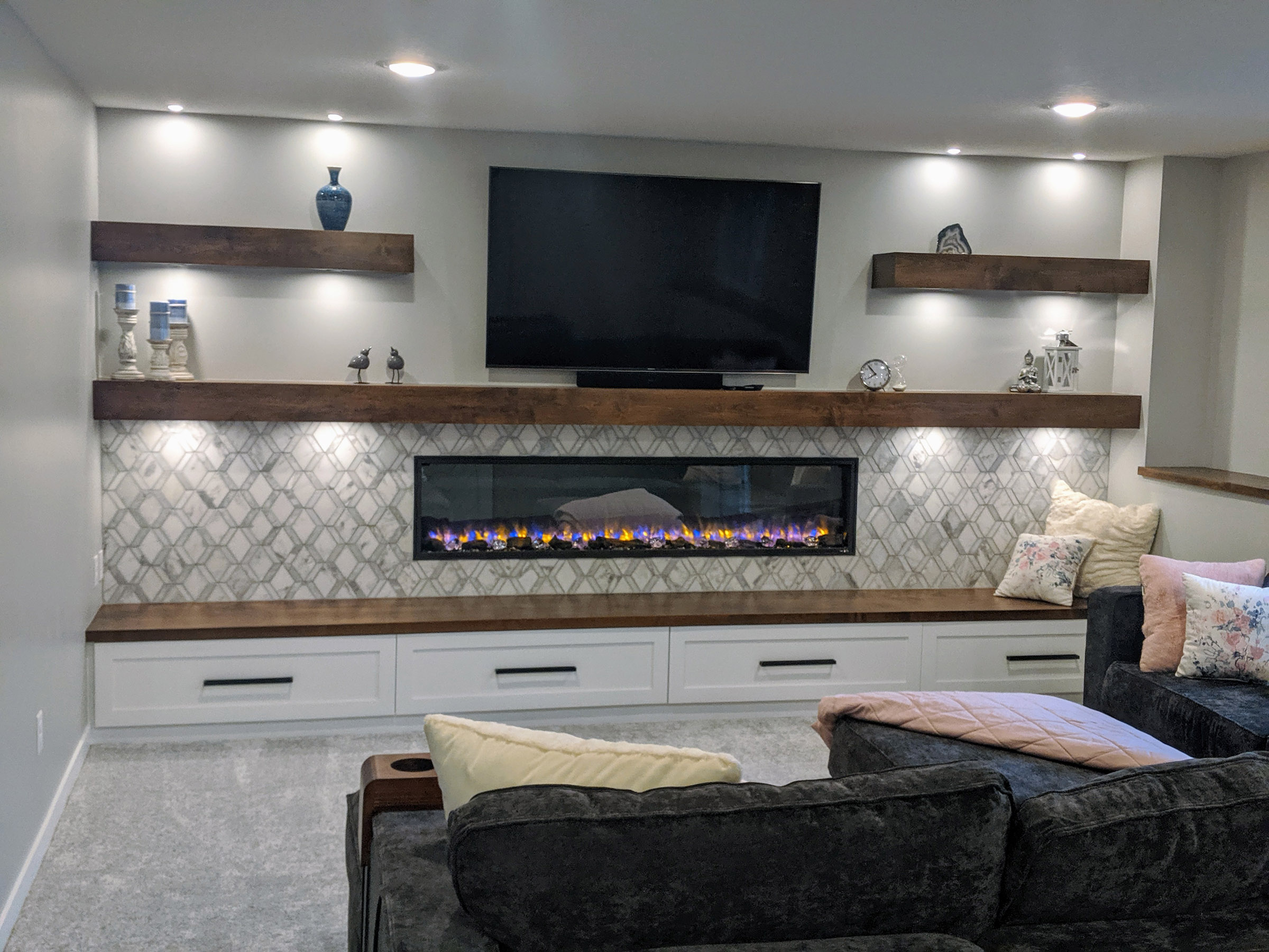 Media wall boasts a 78″ electric Fireplace, 65″ TV