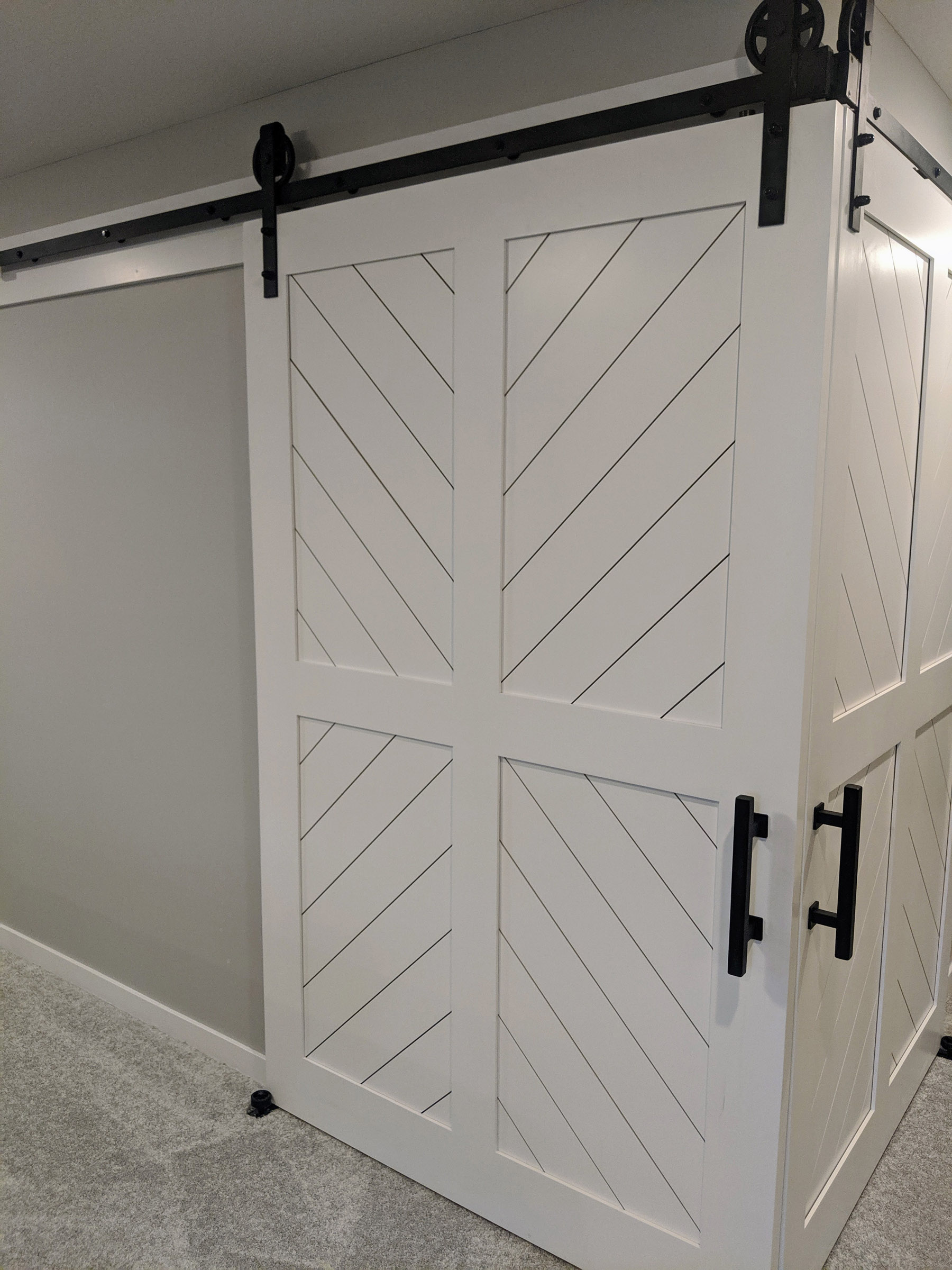 A set of Corner 5' x 7' Custom track doors, open the space to the guest bedroom