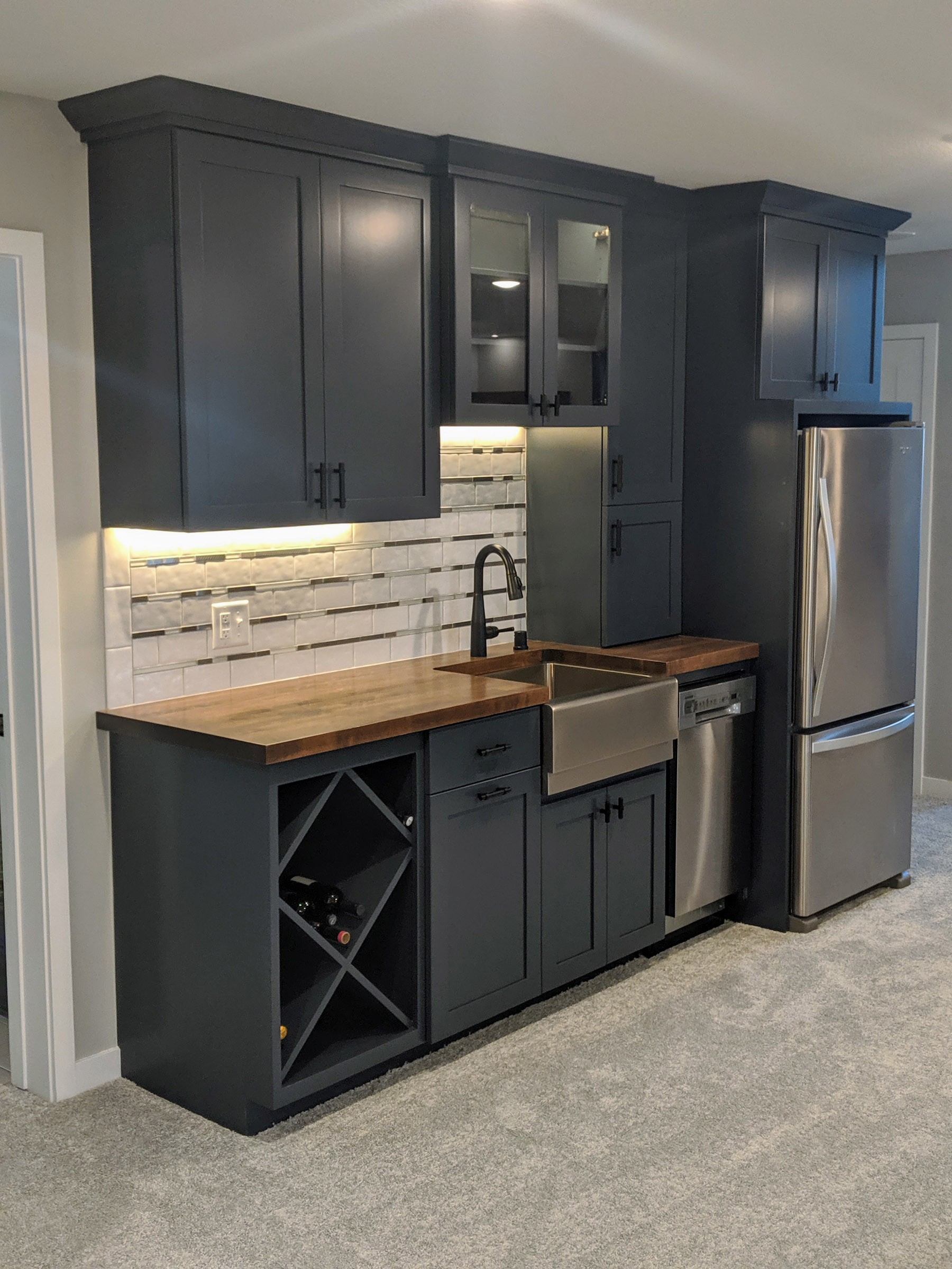 Wet Bar stands out w/ Navy Enameled Cabinets