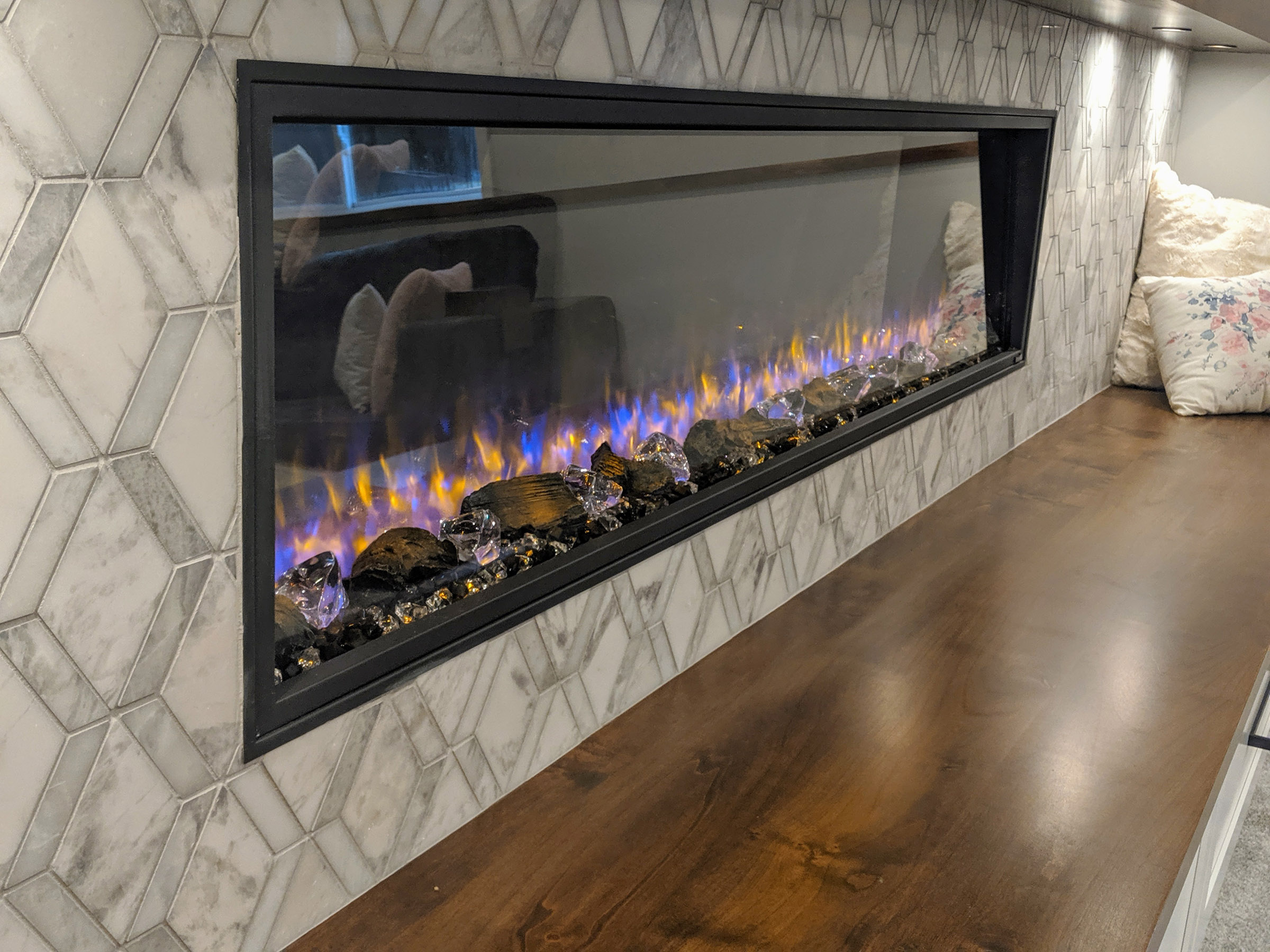 Media wall boasts a 78″ electric Fireplace