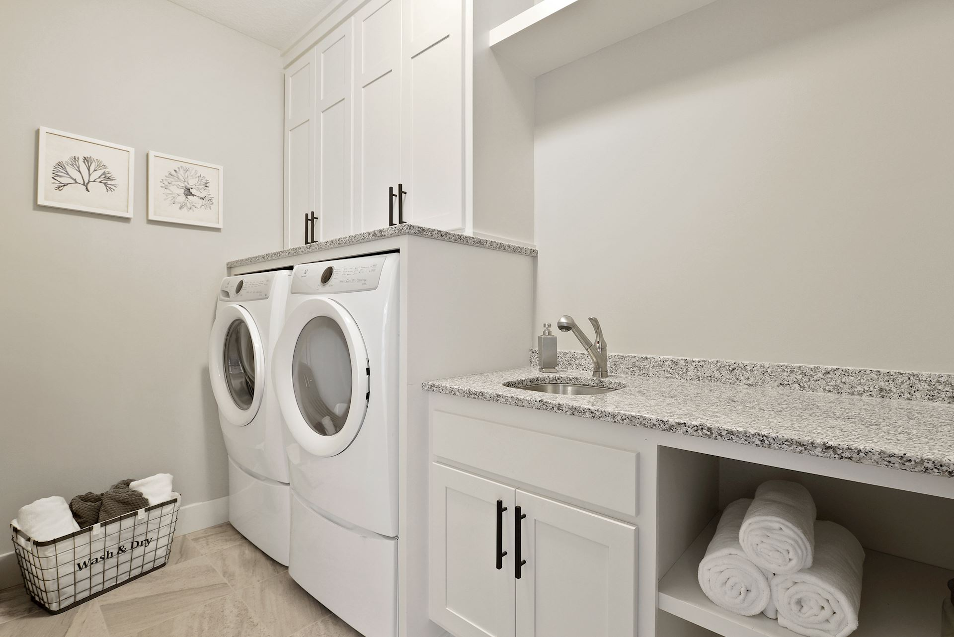 Laundry Room applicance on pedestals and granite counters