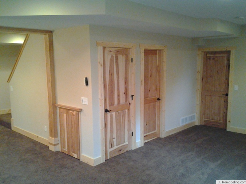 Knotty Pine Walls and Custom Hickory Raised Panel Doors