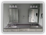 Medium grey Quartz vanity top w/ under mount bowlsChrome finishes & hardware