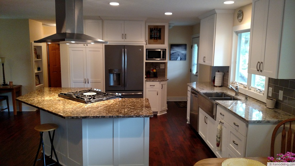 White Cabinets w/contrasting appliances
