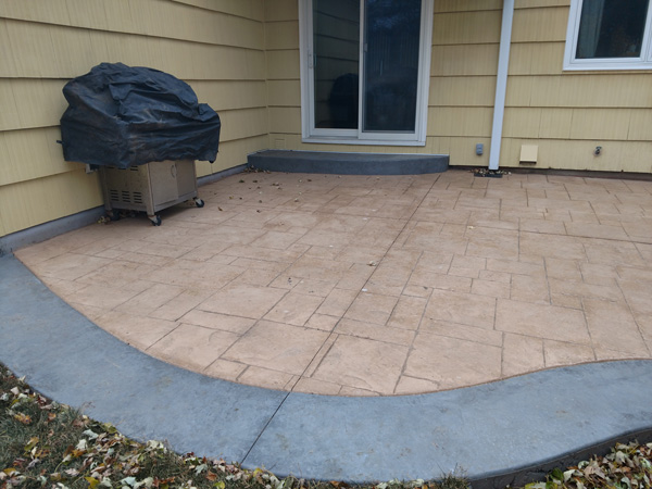 Colored concrete border and curved concrete step