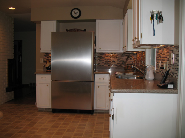 Kitchen Before Remodel - add 1-1/4″ red oak flooring