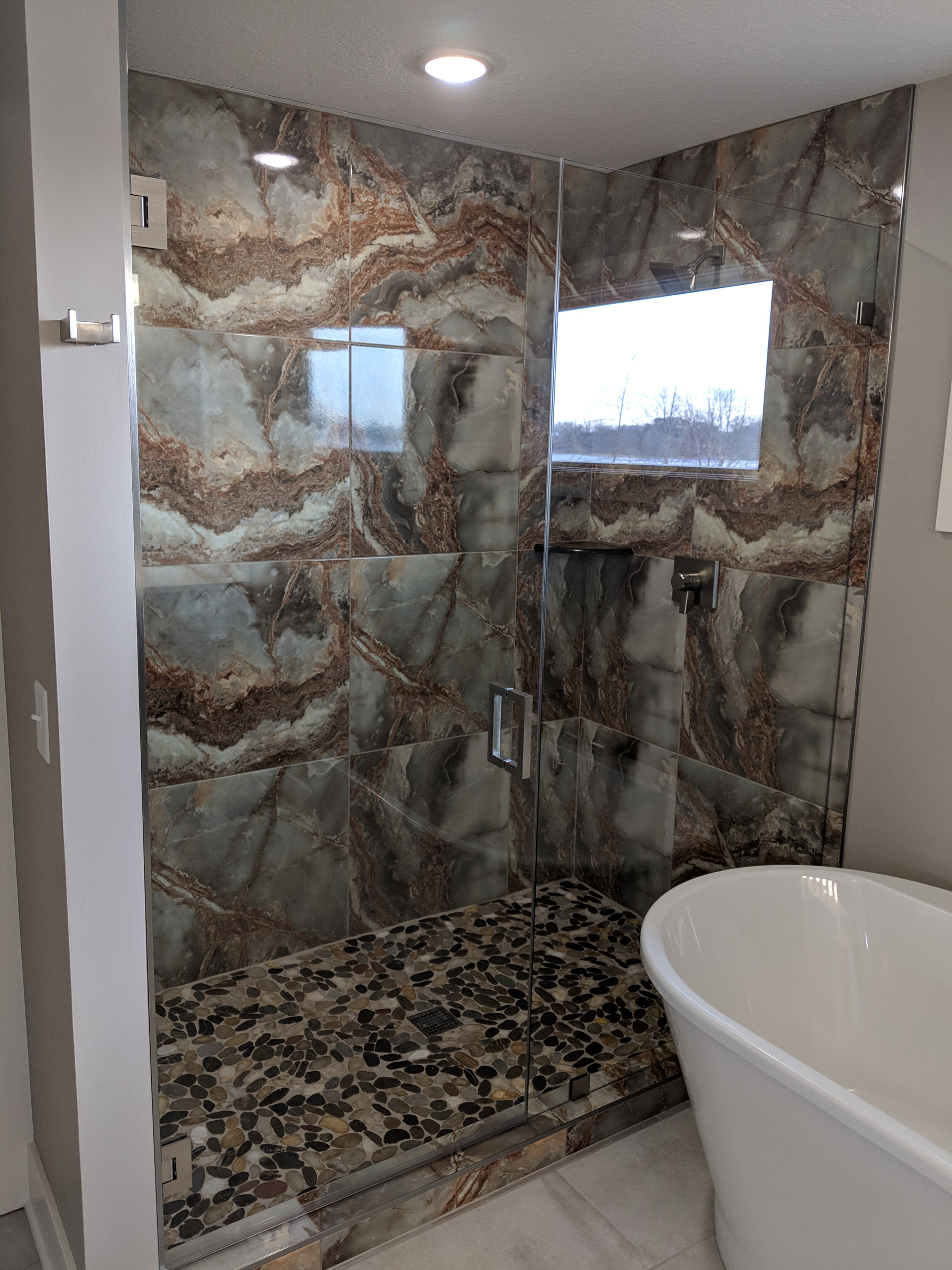 Stunning stone and tile shower with glass door