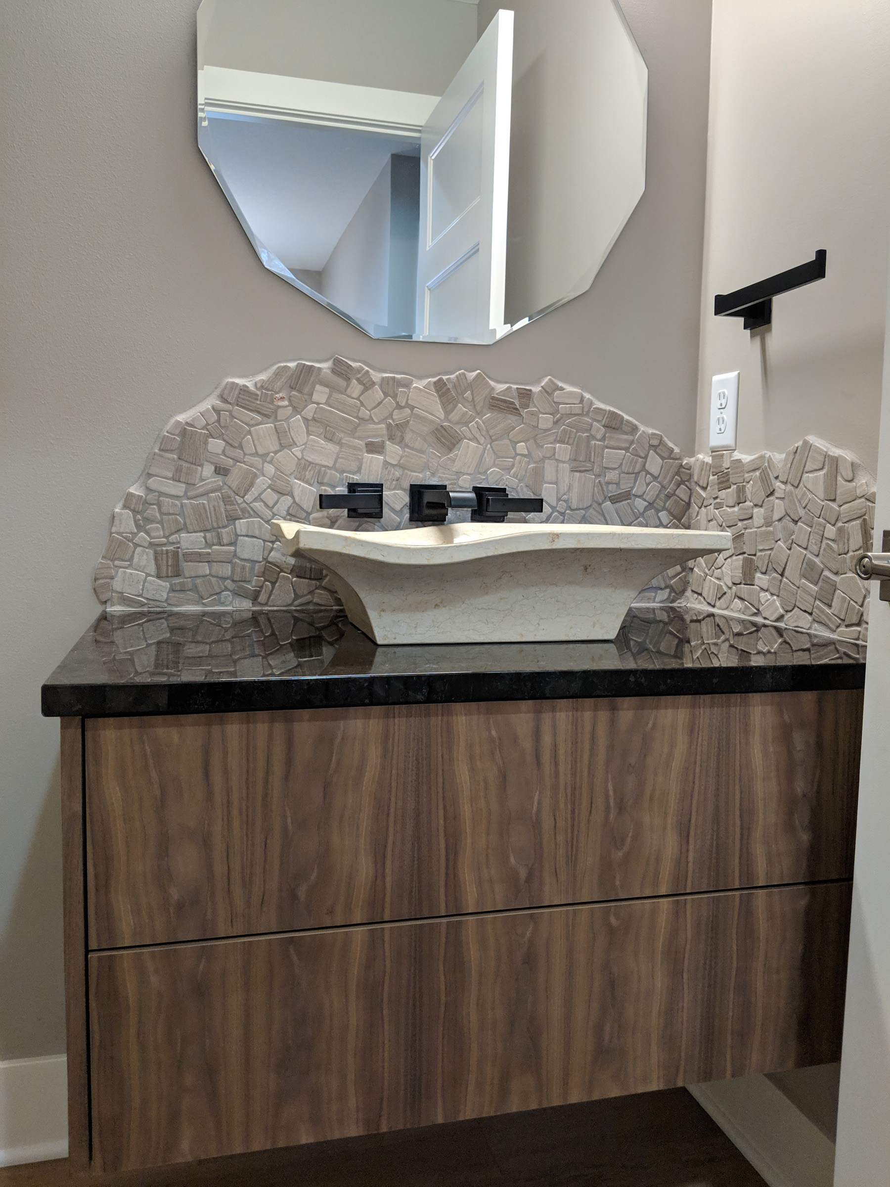Top mount vessel sink with stone backsplash